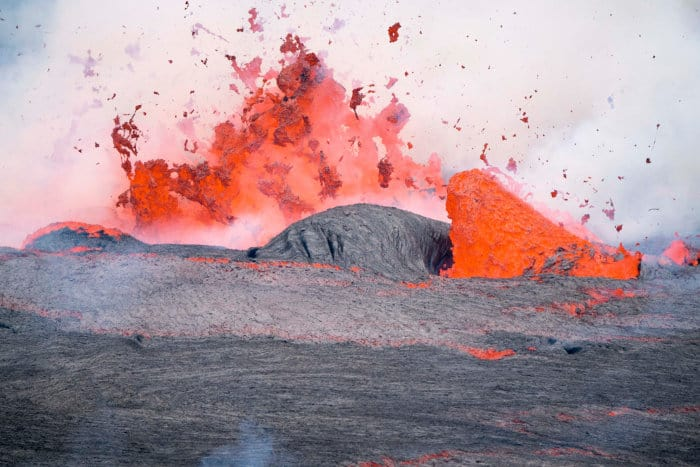 Close-up of the lava lake spitting flames, inside Nyiragongo volcano