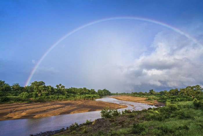 Rainbow across Shingwedzi river in Kruger