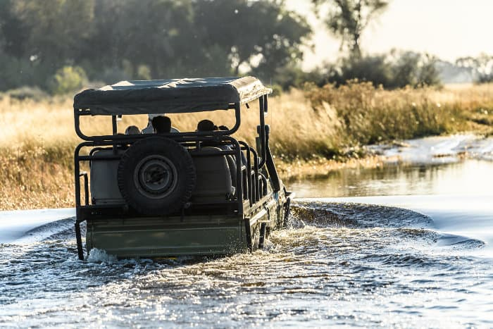 Land cruiser passing through water in the Delta