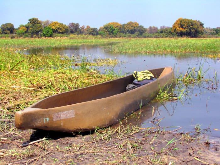 Mokoro boat on the bank of the Okavango river