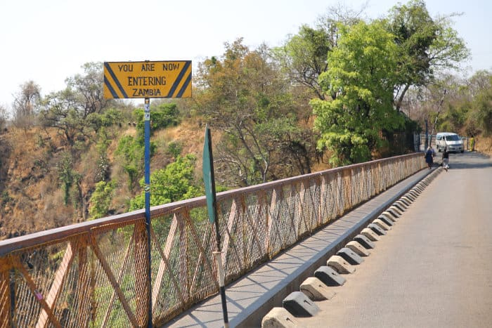 """You Are Now Entering Zambia"" sign on the Victoria Falls Bridge"