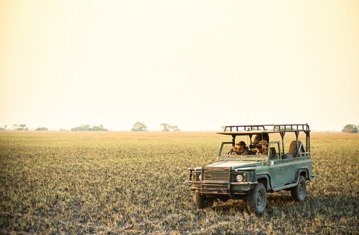 Game drive vehicle at sunset in Kafue National Park