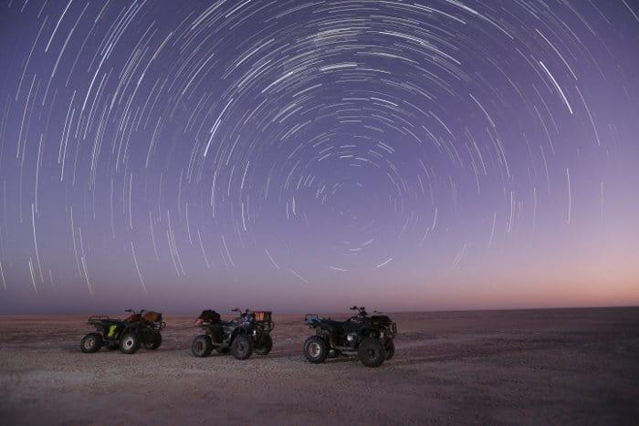 Star trail over quad bikes in Nxai Pan