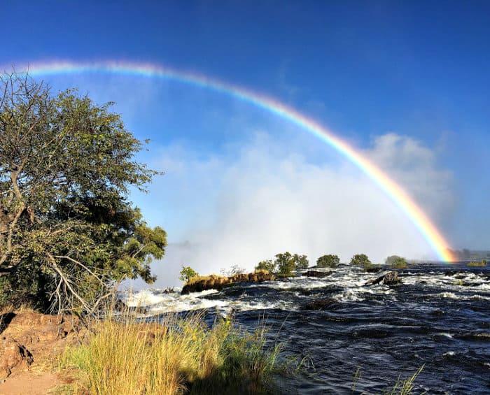 Rainbow over Victoria Falls during the rainy season