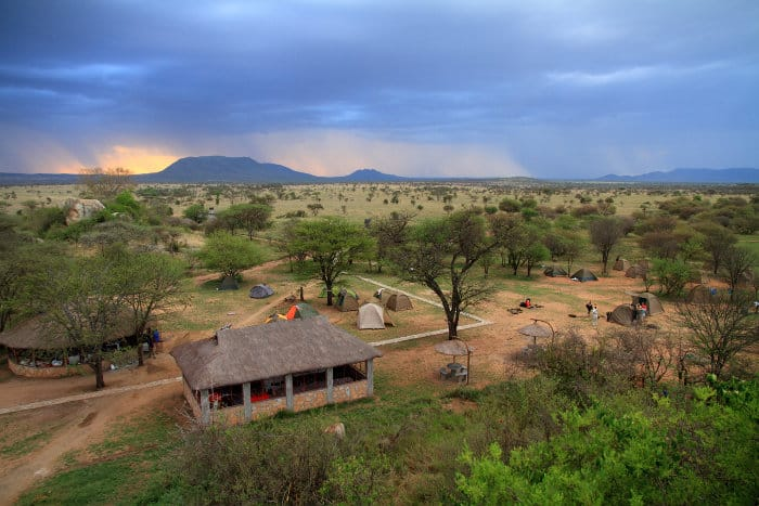 Safari camp in the Serengeti, with storm moving in