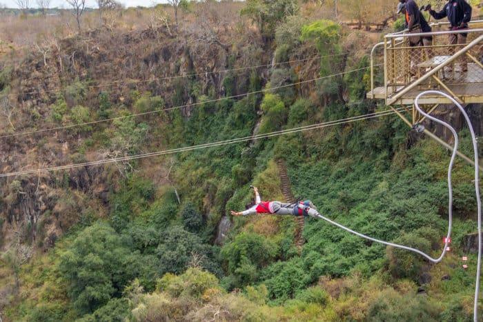 Teenage girl jumping off Victoria Falls Bridge