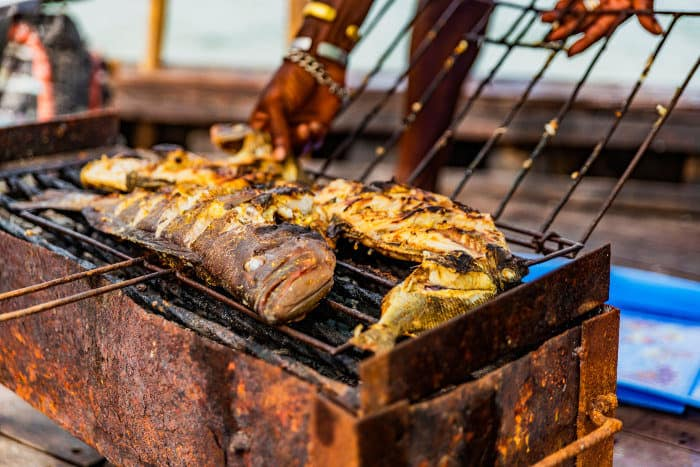 Freshly caught seafood being grilled on the barbecue