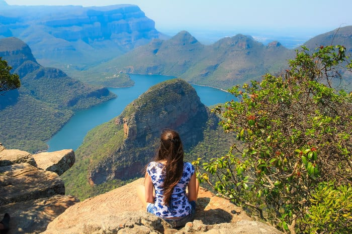 Girl sitting on the edge of a cliff in Blyde River Canyon