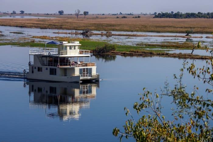 House boat cruising along the Chobe River in Botswana