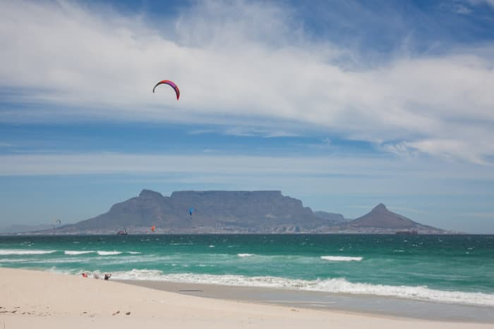 View of Table Mountain from Blouberg Beach, with kitesurfers