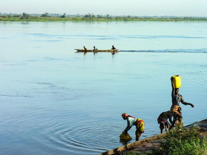 Women fetching water from the Congo River, Katanga