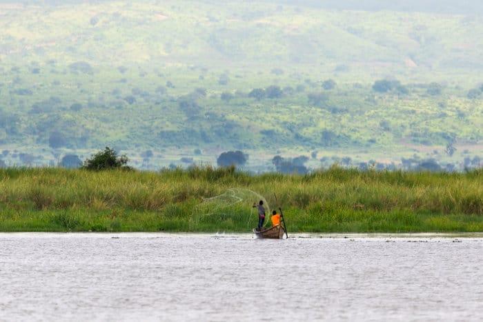 Fishermen throwing their nets in Lake Albert, Uganda