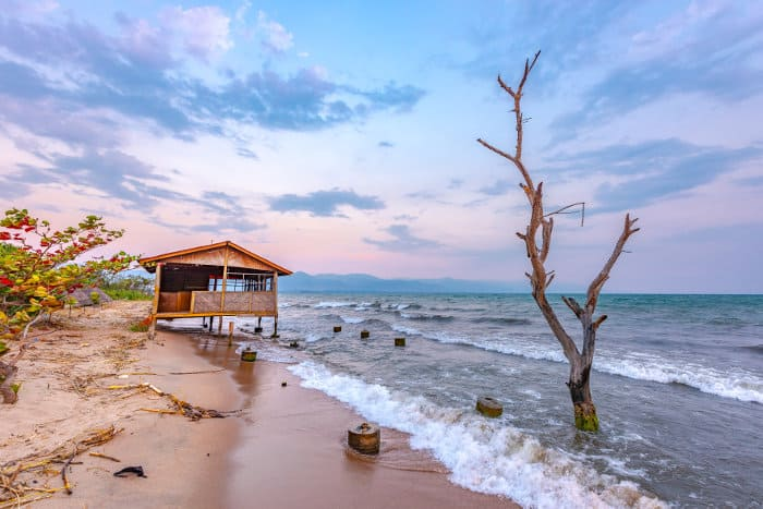 Wooden house on stilts, standing partly in water, Lake Tanganyika