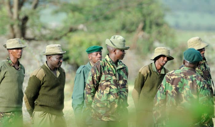 Group of game rangers being briefed for the day, Masai Mara