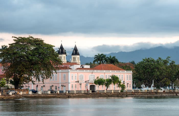 """São Tomé palace, with """"Our Lady of Grace Cathedral"""" emerging from behind"""
