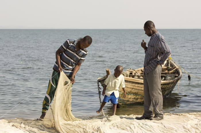 Two fishermen inspecting their nets, Speke Bay, Lake Victoria