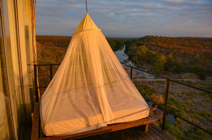 Bed and mosquito net overlooking the river - one of the best ways to sleep in the African bush