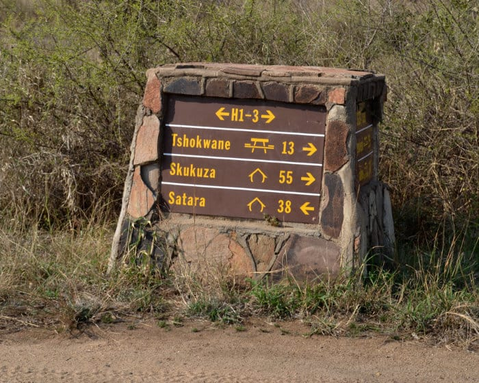 Typical road signs in Kruger National Park - this one showing distances between the Skukuza and Satara rest camps