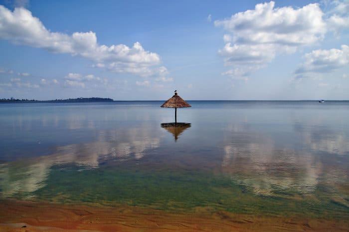 Beach 'umbrella' hut submerged in water, Buggala Island