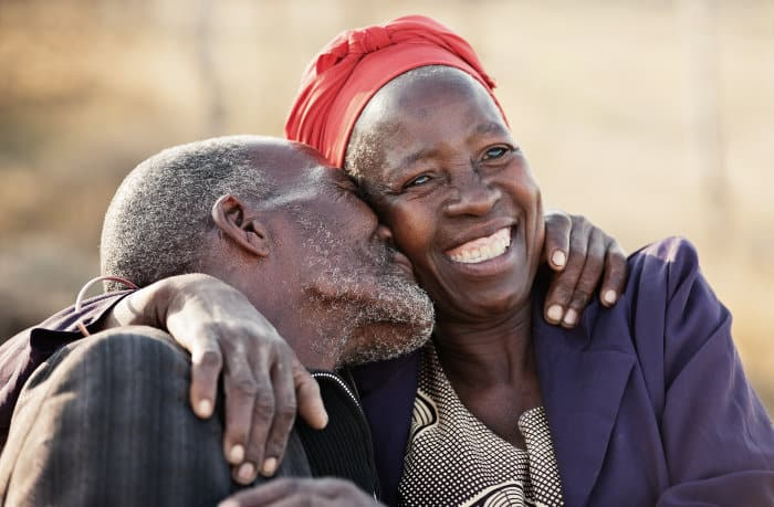 African couple showing tender signs of love