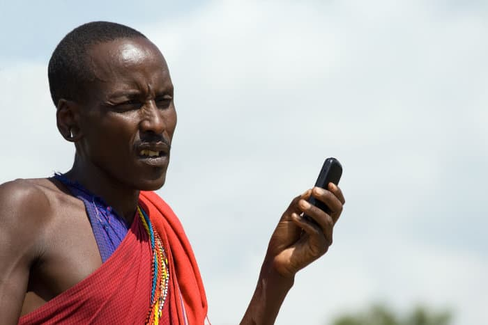 Native Masai holding a cellphone in his hand