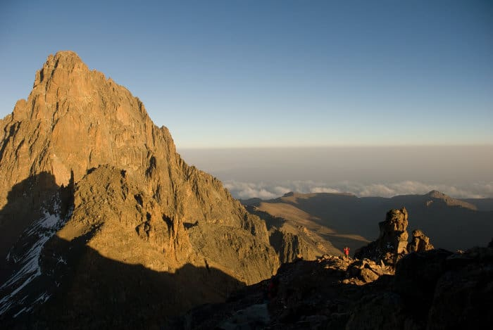 Climber stops to admire the view, as it reaches the top of Mount Kenya