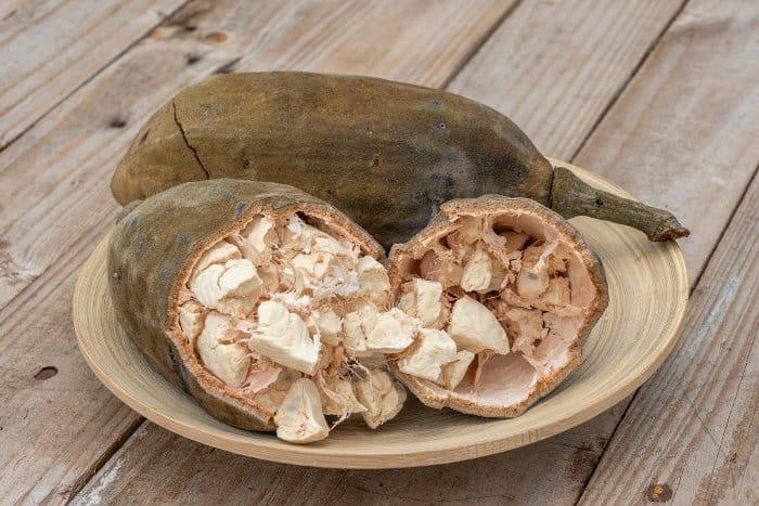 Open baobab fruit on a plate, Zanzibar