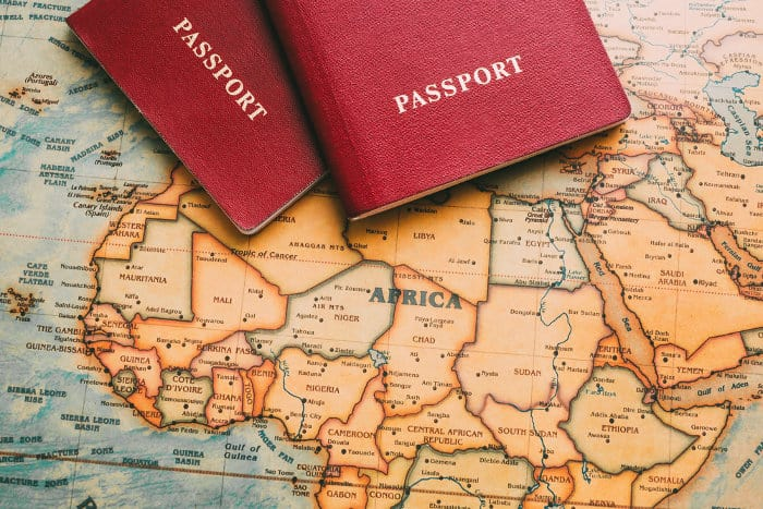Two passports on an Africa map - visas for Africa