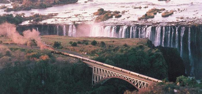Rovos Rail train crosses a bridge in Victoria Falls