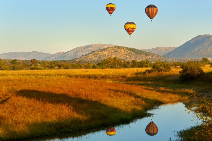 Three hot air balloons over the Pilanesberg Game Reserve