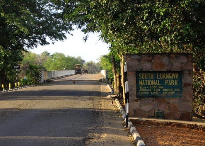 The entrance gate to South Luangwa National Park, with Luangwa bridge in the background