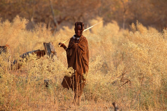 Young Himba looking after cattle in the Namibian bush