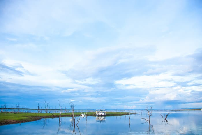 Houseboat on Lake Kariba, with cloud reflections on the water