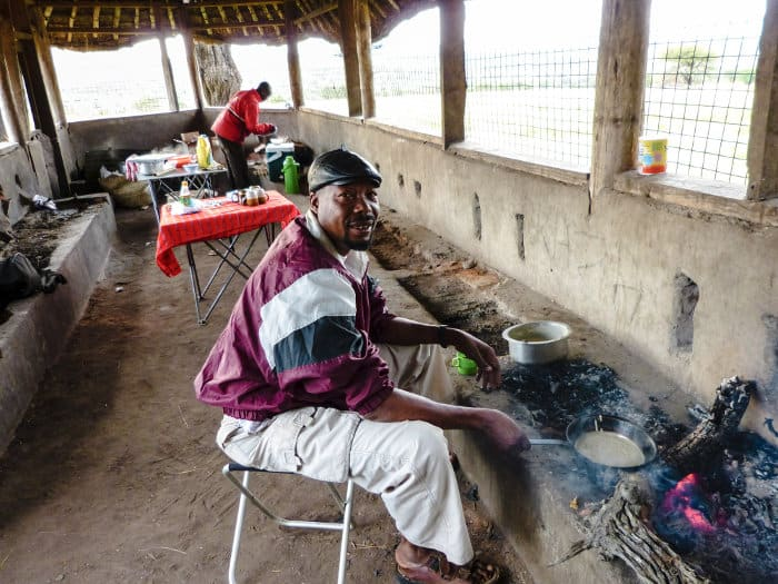 Local cook making pancakes for guests, in the Serengeti National Park