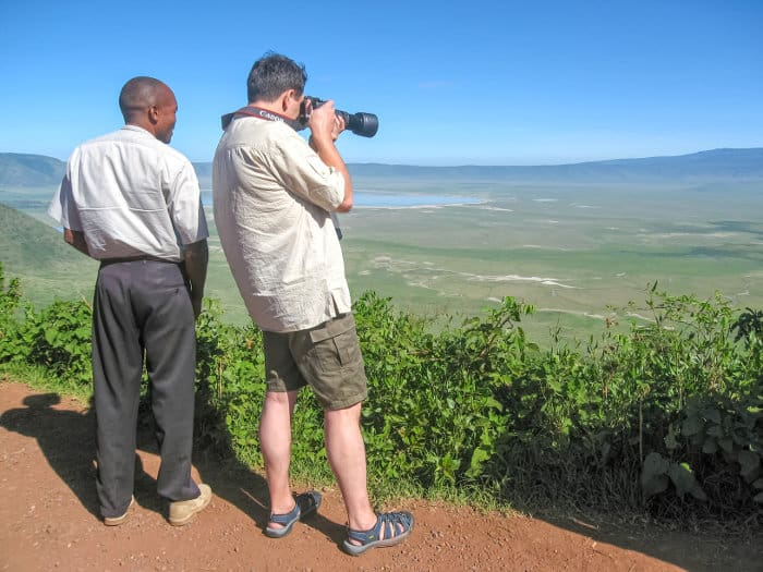 Safari guide and tourist on the edge of the Ngorongoro Crater
