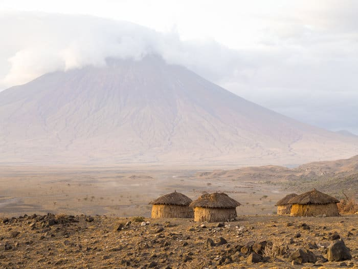 Maasai village and Ol Doinyo Lengai - the Mountain of God - in the background