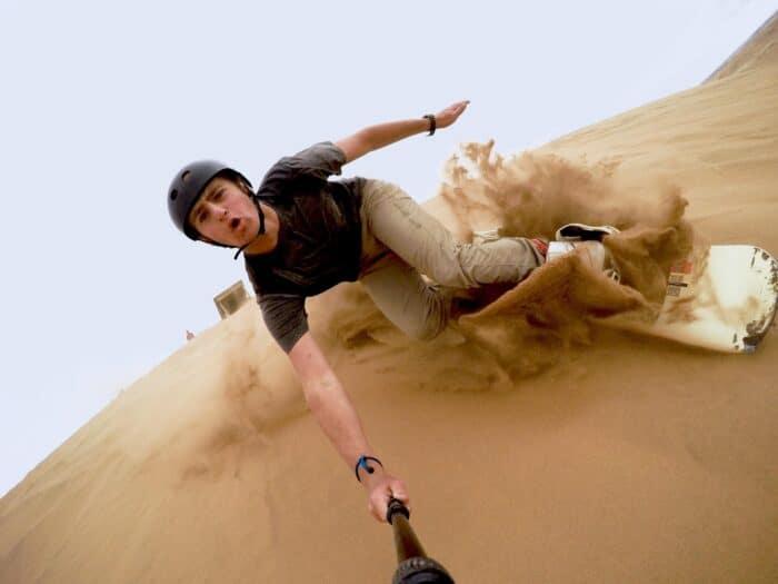 Sandboarding in the dunes, Namibia