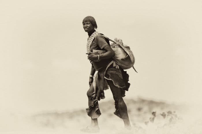 Hamar woman on her way to the market, Omo Valley, Ethiopia