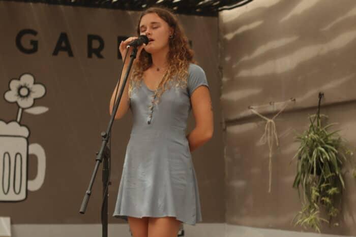 Girl singing at Soundgarden, Namibia
