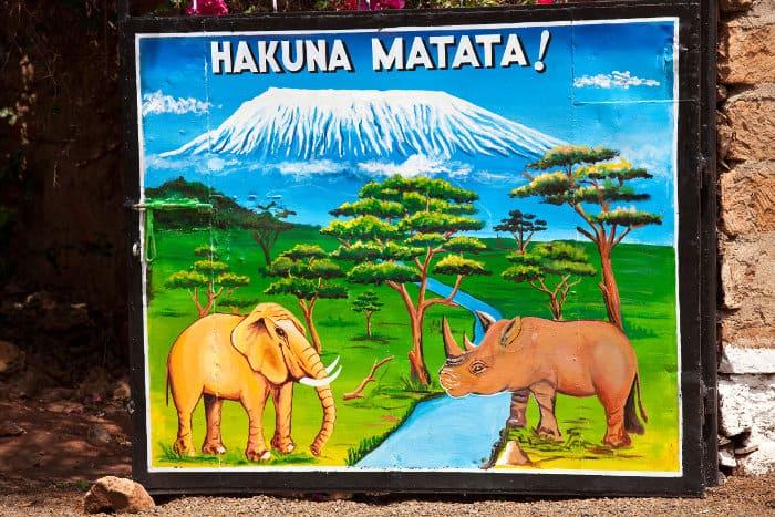 Hakuna matata sign, with elephant (tembo) and rhino (kifaru) in front of the Kilimanjaro